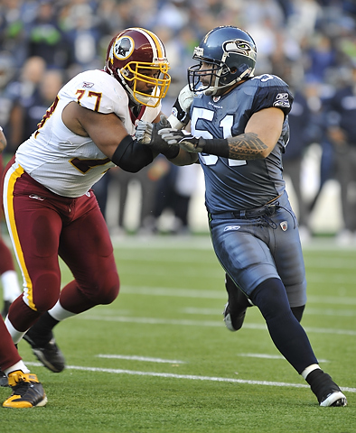 Lofa Tatupu vs. the Redskins. Photo by Steve Kajihiro